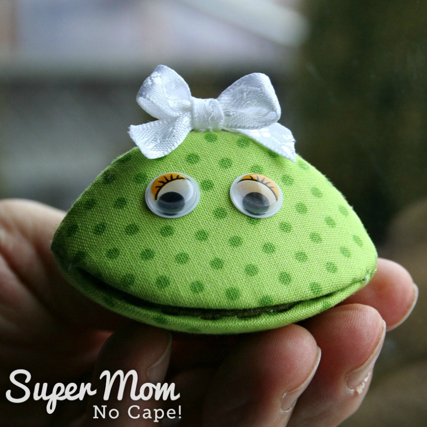 Photo of Frannie Frog made from a thimble pip being held on a man's hand
