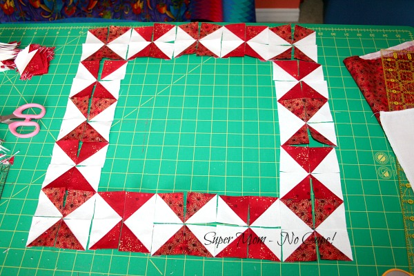 HST frame for Christmas mouse wallhanging laid out and ready to sew.