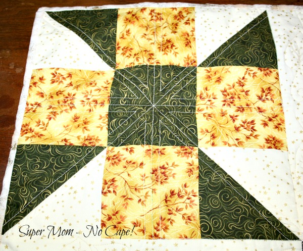 Blocked quilted with an X and a Cross