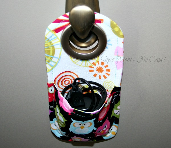 Cellphone charging station with charging cord tucked inside the pouch.