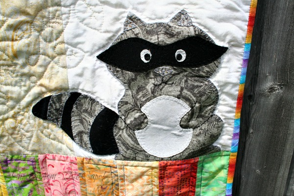 The appliqued raccoon on my Forest Friends Quilt.