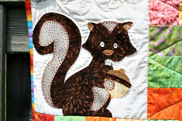 The appliqued squirrel on my Forest Friends Quilt