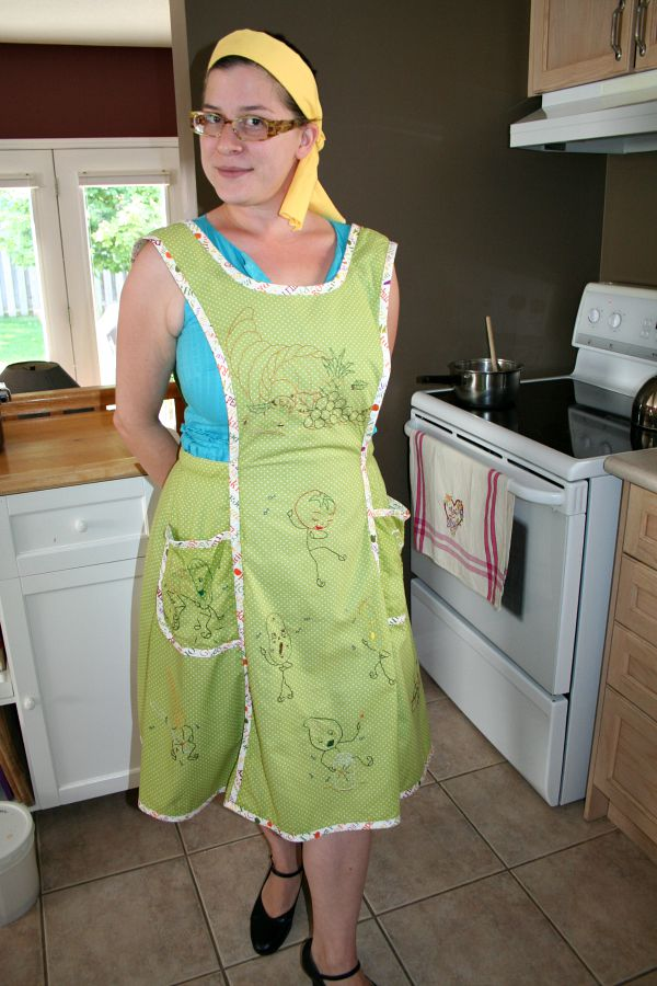 another photo of middle daughter modeling the apron