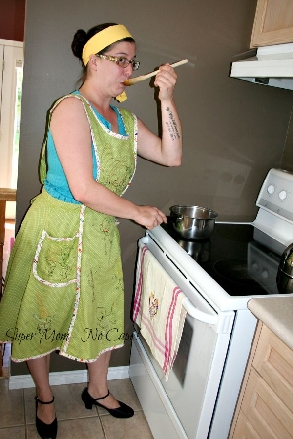 second photo of middle daughter modeling apron