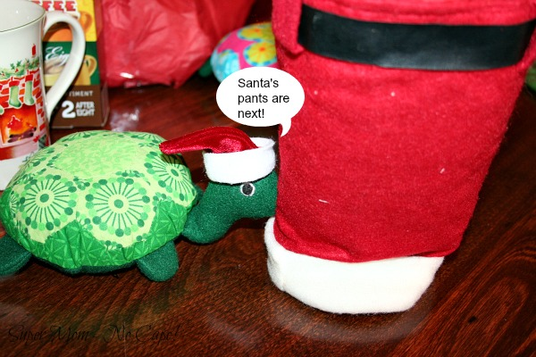 Photo of Rexie pushing the Santa pants gift bag