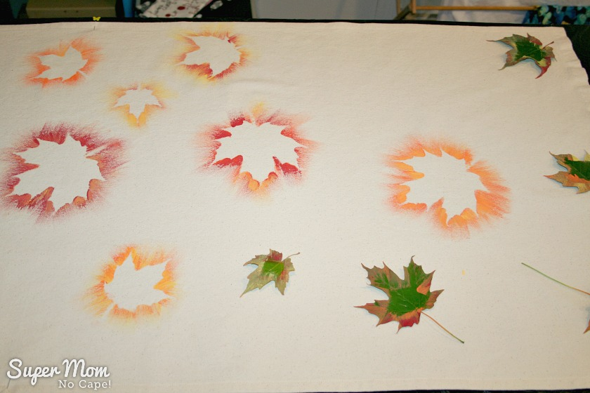 Several painted leaves plus addition leaves ready to be painted on the Painted Maple Leaf Table Runner