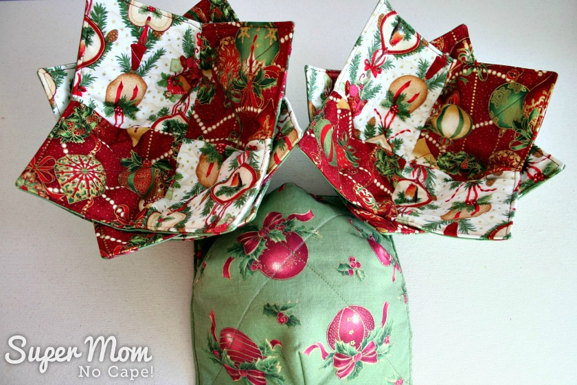Christmas Charm Square Soup Bowl Cozies - 6 soup bowl cozies showing the coordinating backing fabric