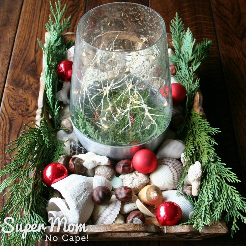 Elegant Beach Christmas Decor - Tray of sea shells christmas ornaments and greenery