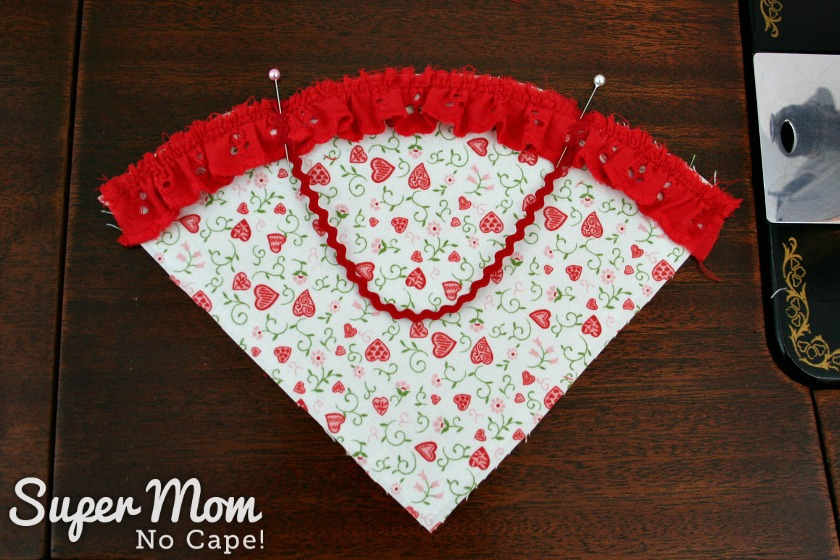 Pin ricrac handle over the gather red eyelet trim