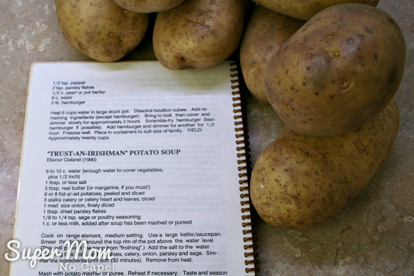 Cookbook opened to recipe called Trust an Irishman Potato Soup