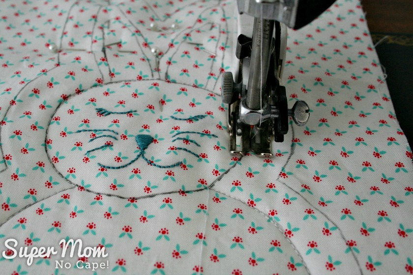 Sewing around the head of the rag quilt bunny