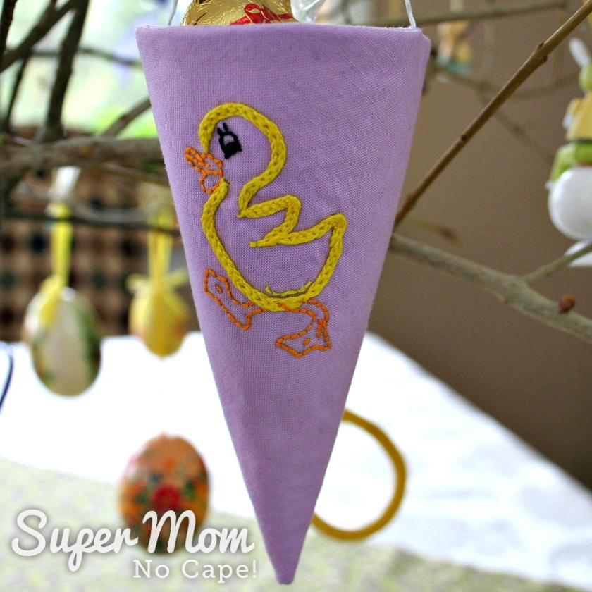 Fabric cone embroidered with a yellow duckling