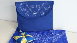 Sashiko embroidery pattern - Making Waves embroidered in white on blue pouch