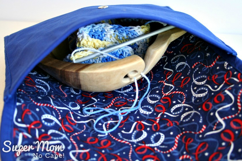 Yarn bowl and crochet in progress inside Making Waves Sashiko Embroidered Pouch