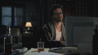Supernatural's Chuck Shurley at the computer in a bathrobe.