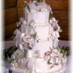 Four Tier Fondant Wedding Cake – Flowers and Bows