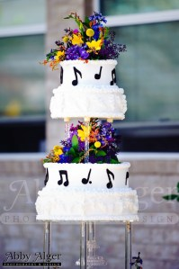 Picture of music themed wedding cake with music notes as decorations