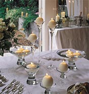 Reception tables decorated with ball candles in glass holders