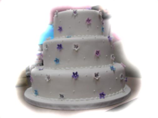 Spring Wedding Cakes Photo - three tier with pansy design