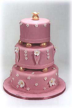 picture of three tier wedding cake in pink fondant