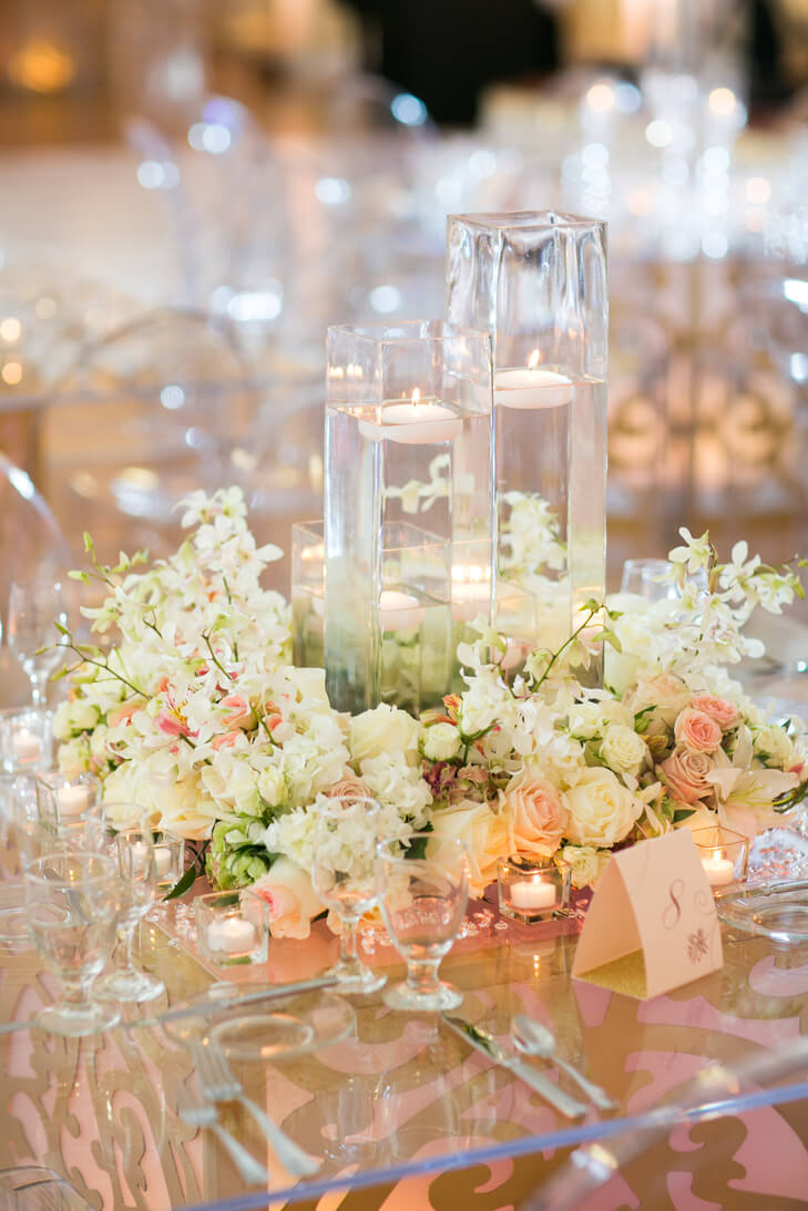 Floral wreath wedding centerpieces with floating candles for Floral wedding decorations ideas