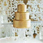 Gold Wedding Cake on A Cake Stand With Hanging Crystals