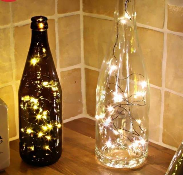 Wine bottle lighted wedding centerpieces