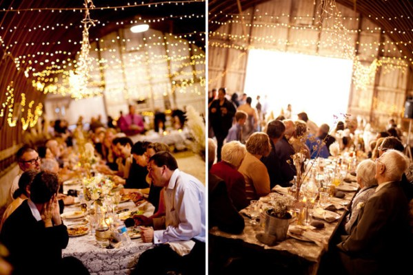 The dinner reception at a rustic barn wedding
