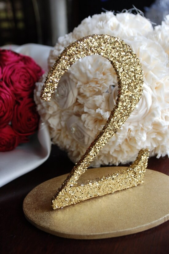 Gold glittered table numbers