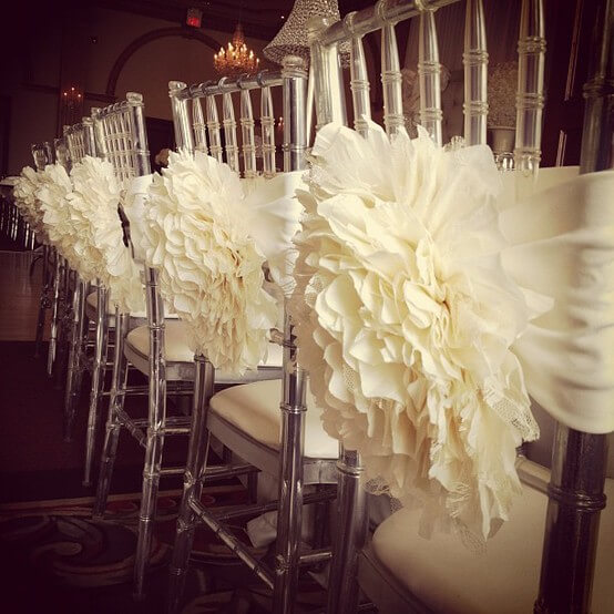 Ruffled decorations for wedding reception chairs