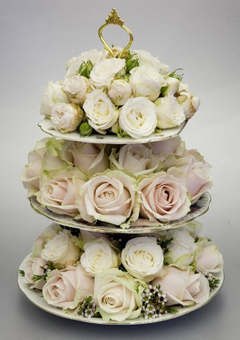 Cake Stand filled with flowers for wedding centerpiece