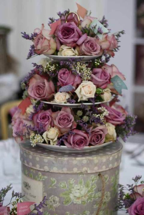 Flowers on a cake stand for wedding
