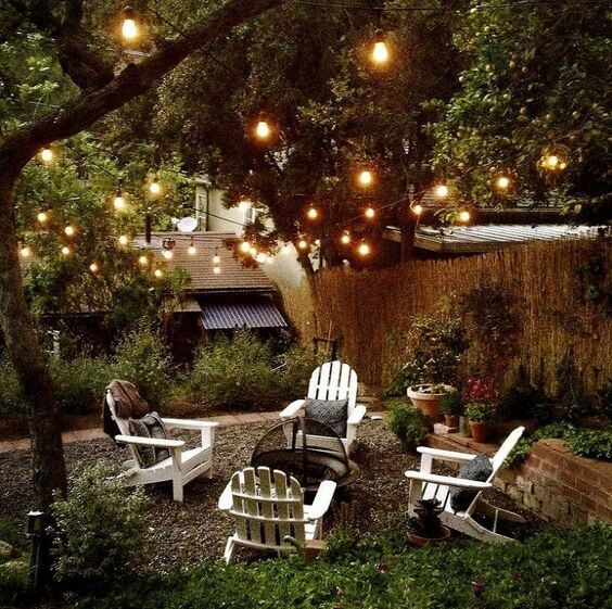 Cozy corner with fire pit at backyard wedding reception