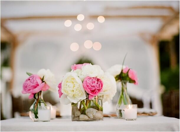 Peony centerpiece in sqaure glass vase for wedding reception