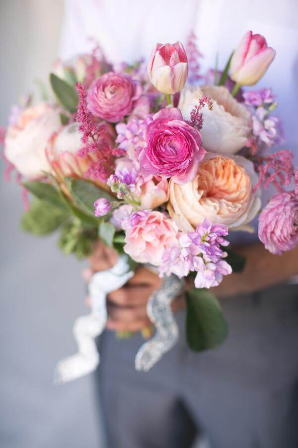 Hand tied spring wedding bouquet of tulips, roses and peonies