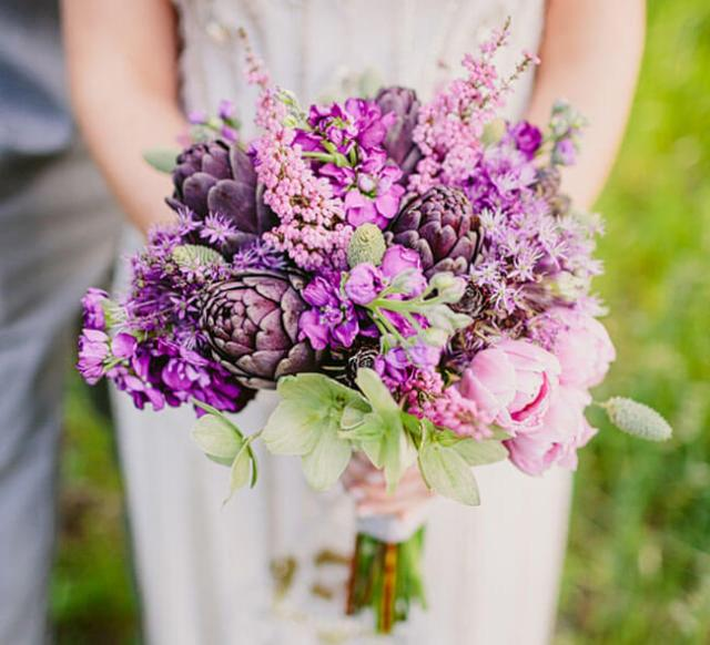 Purple bridal bouquet for spring wedding with lilacs