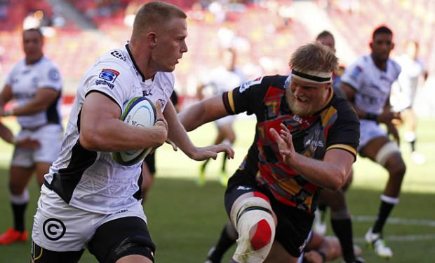 Daniel du Preez of the Sharks runs down the touchline