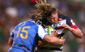 Jordy Reid of the Rebels gets tackled by Dane Hallett-Petty of the Force