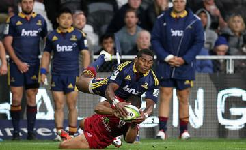 Waisake Naholo is tackled by the Reds