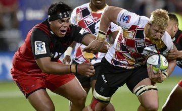 Jacques Engelbrecht (R) of the Southern Kings is tackled by Michael Alaalatoa o