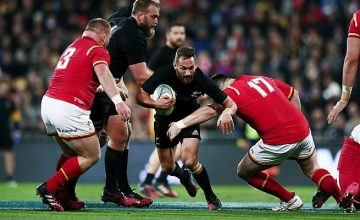 Aaron Cruden runs with the ball before he is tackled