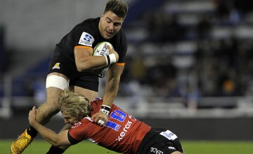Try scorer Facundo Isa protects the ball for the Jaguares