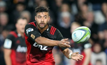 Richie Mounga of the Crusaders passes the ball during the round twelve Super Rugby match between the Highlanders