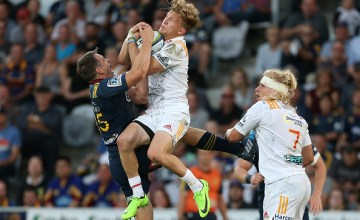 Damian McKenzie of the Chiefs competes for a high Super Rugby ball
