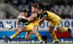 Sonny Bill Williams of the Blues is tackled by Beauden Barrett of the Hurricanes during the round eight Super Rugby match