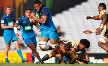 Patrick Tuipulotu of the Blues is tackled during the round six Super Rugby match between the Blues and the Force