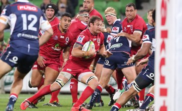 Scott Higginbotham of the Reds runs with the ball during the round 12 Super Rugby match
