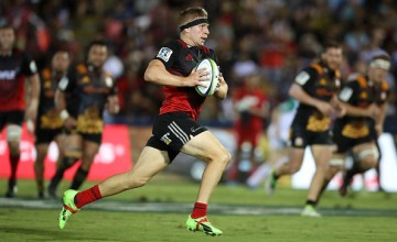 Jack Goodhue of the Crusaders makes a break during the round 13 Super Rugby match between the Chiefs and the Crusaders at ANZ Stadium in Suva, Fiji.