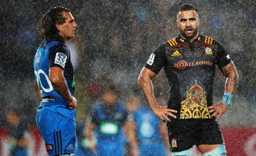 Kara Pryor of the Blues and Liam Messam of the Chiefs look on