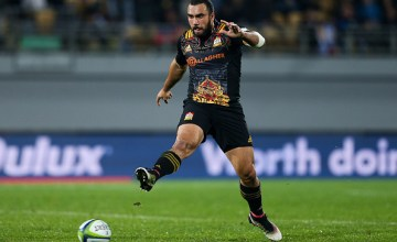 Charlie Ngatai of the Chiefs kicks during the round 11 Super Rugby match between the Chiefs and the Reds